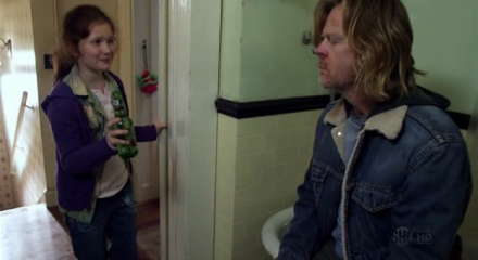 Debbie offers her dad a beer.