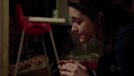 Fiona Gallagher (Emmy Rossum) imagines her passed-out father thanking her for her hard work.
