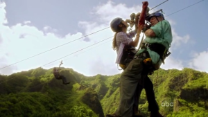 Lily Brenner (Caroline Dhavernas) treats a patient while hanging from a zipline.
