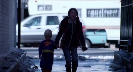 Debbie and little Casey Casden walking down an alleyway.
