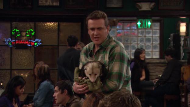 At Maclarens, Marshall (Jason Segel) shows the gang his new possum friend Rex.