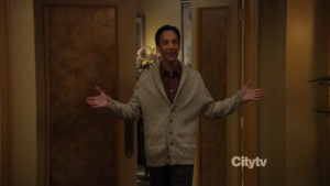 Abed (Danny Pudi) throws his arms out in welcome, walking through an expensive restaurant.