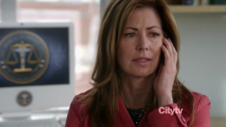 Dr. Megan Hunt (Dana Delany) listens to bad news on the phone.