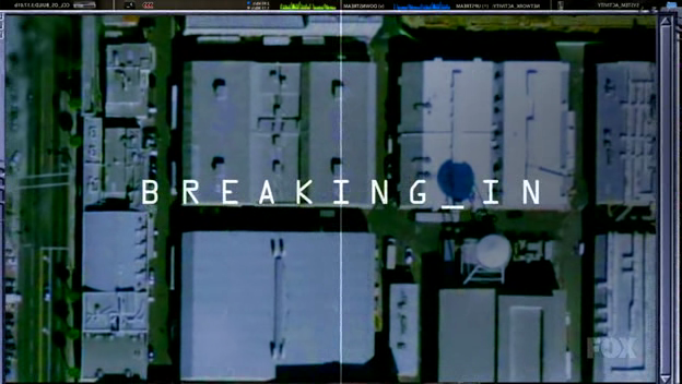 The series title, BREAKING_IN, over the view of a city from a satellite camera above.