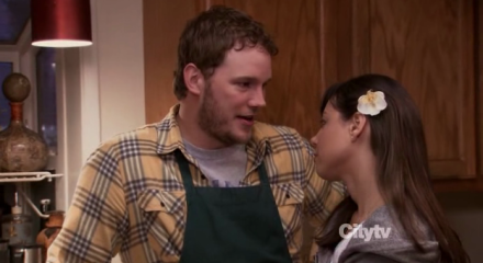 Andy (Chris Pratt) and April (Aubrey Plaza) share an excited look.