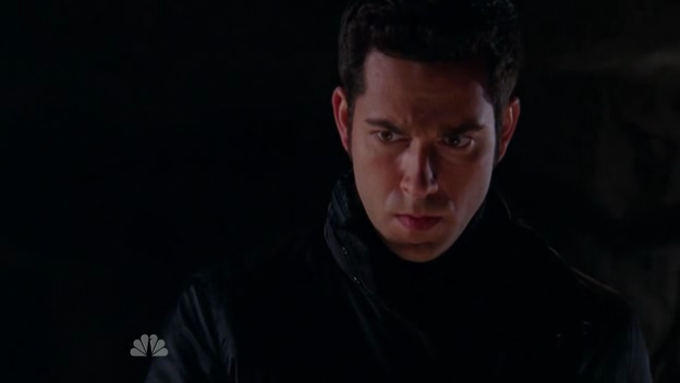 Chuck (Zachary Levi) in dark clothes, looking serious.