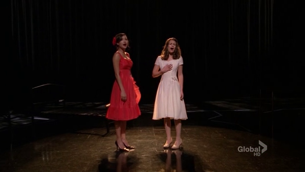 Santana, as Anita, and Rachel, as Maria, on stage for West Side Story.