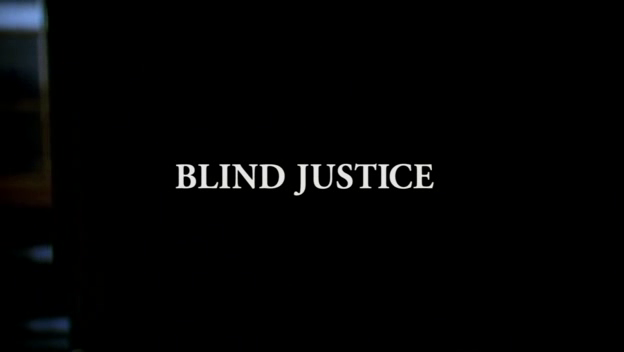 White text, BLIND JUSTICE, against a black background.